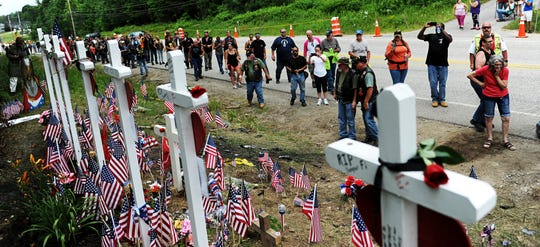 In this July 6, 2019, file photo, motorcyclists visit a memorial for seven bikers killed in a collision with a pickup truck last month while participating in the Ride for the Fallen 7 in Randolph, N.H.