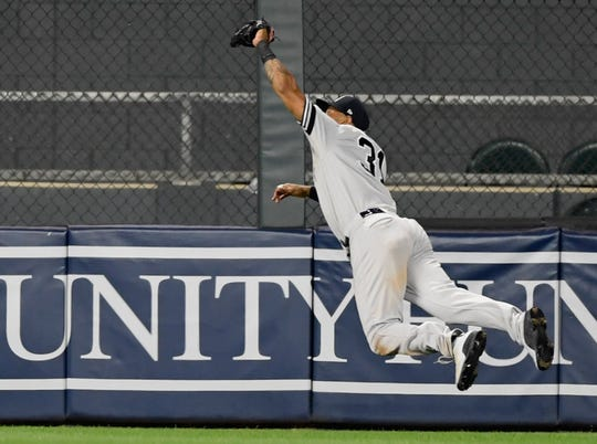Aaron Hicks makes a game-saving diving catch in the 10th inning against the Twins.