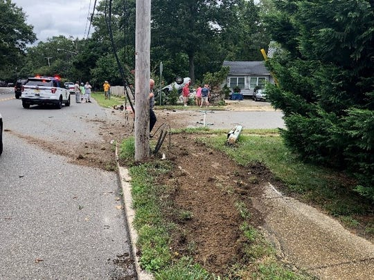 A Berkeley woman was hospitalized after her car came to rest on top of another one in Toms River on July 23, 2019.
