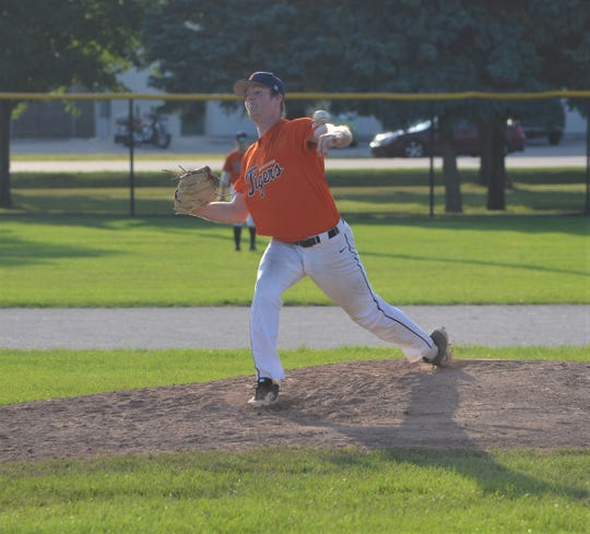 Ryan Abenth of the Mid-Michigan Tigers  throws home during the City Major Championship Series at Bailey Park on Wednesday.