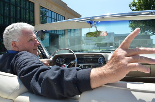 Ron Harshman gives a tour of the Gilmore Car Museum in Hickory Corners while driving a 1963 Cadillac Convertible on Wednesday, July 24, 2019.