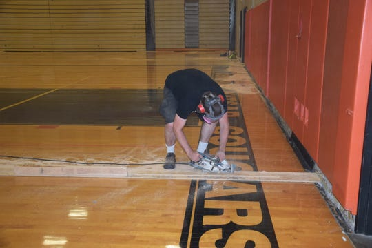 Shawn Cupples of skatetown.org makes cuts to the CKHS gym floor, which will be used for roller skating in the future.