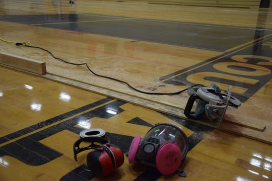 The cutting of CKHS gym flooring has begun, it was purchased by skatetown.org, an initiative to save skating in Kitsap County.