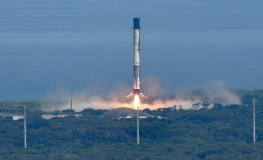 A SpaceX Falcon 9 booster lands at LZ-1 Thursday, July 25, 2019,  The rocket lifted off at 6:01pm EST carrying supplies for the International Space Station. Mandatory Credit: Craig Bailey/FLORIDA TODAY via USA TODAY NETWORK