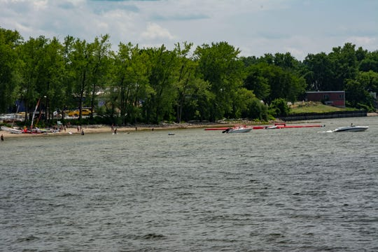 The Burlington Surf Club, with a SUP polo arena anchored offshore.