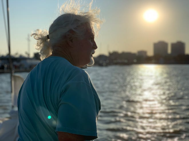 A sailor looks out at the water in Corpus Christi's downtown marina.