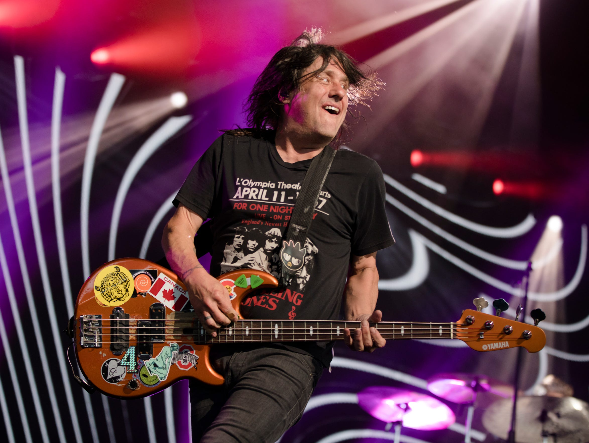 Robby Takac, Goo Goo Dolls' bass guitarist, performs on Wednesday July 24, 2019, at Riverbend Music Center in Cincinnati. 