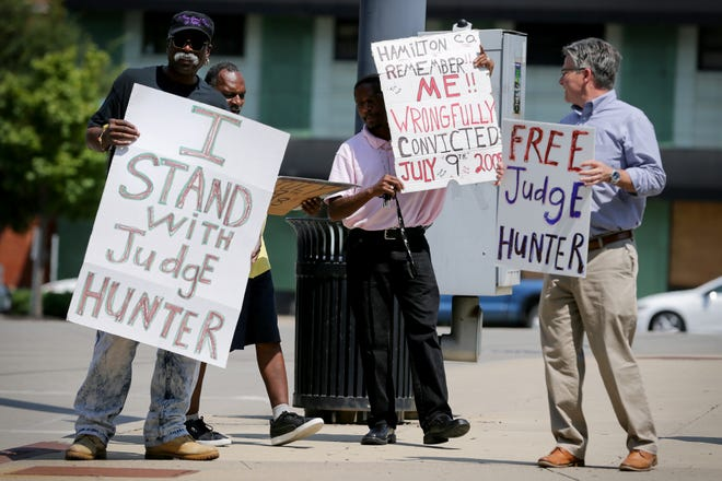 About eight people gathered to protest the incarceration of former Hamilton County Judge Tracie Hunter, Thursday, July 25, 2019, at the intersection of Eggleston and Central Avenue in Cincinnati. Hunter was sentenced to six months in jail on Monday.