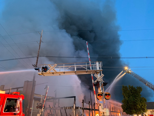 Firefighters are battling a massive warehouse fire in Hamilton on Thursday morning. Homes in the area have been evacuated.