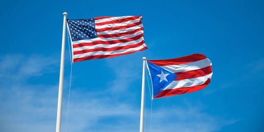 Flags of the United States and Puerto Rico.