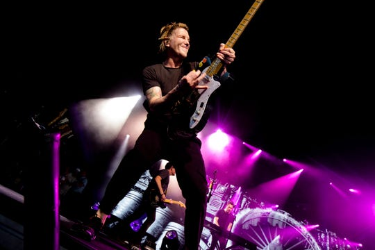 John Rzenznik, Goo Goo Dolls' guitarist and vocalist, performs on Wednesday July 24, 2019, at Riverbend Music Center in Cincinnati. Goo Goo Dolls performed before Train.