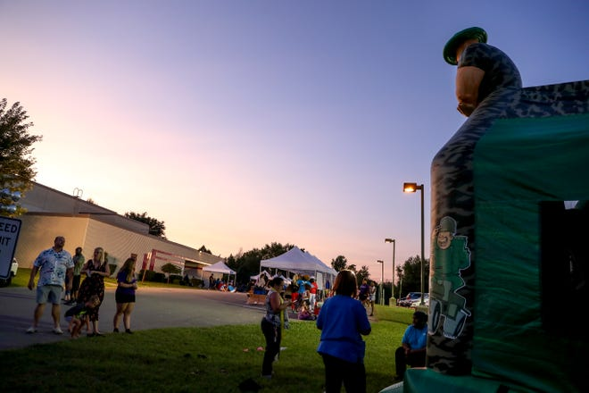 Visitors mingle at the Summer Night Lights event at the Kleeman Recreation Center in Clarksville on July 24, 2019. The city is currently looking for a suitable site for a proposed regional recreation center.
