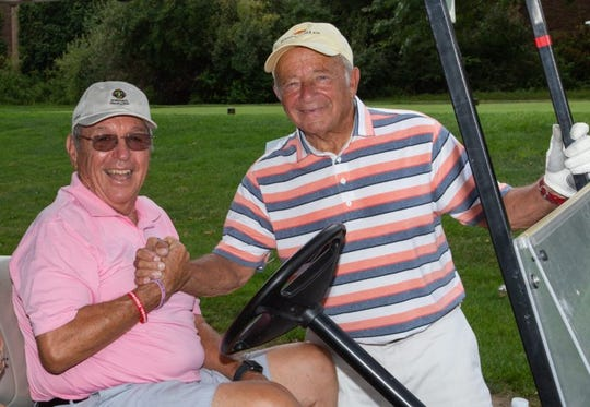Charles J. Gatt and Martin Galuskin participate in the 5th Annual Gatt Golf Tournament.