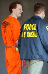 Dustin Honken is led by U.S. marshals from the federal building in Sioux City, Iowa, Wednesday, Oct. 27, 2004, after the jury chose the death sentence for Honken in the execution-style slayings of two children who were among five people killed in 1993 to protect his drug business. Honken will be executed in 2020, the federal government said.