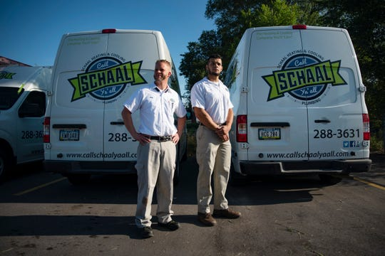 Joe Anderson, left, and Jared Linderman pose for a portrait at Schaal Plumbing, Heating and Cooling in Des Moines. Schall was named the No. 1 small employer by Iowa Top Workplaces.