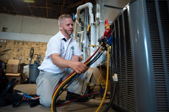 """Joe Anderson adjusts HVAC and furnace electrical components during a regular training session at Schaal Plumbing, Heating and Cooling on July 25, 2019. """"It's never boring,"""" Anderson said. You get to meet new people every day. And sometimes we get to break stuff, fix stuff, play with fire and chemicals."""" Anderson started at Schaal in early 2019."""