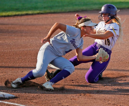 Heidi Wheeler of Waukee tags out Sophie Maras of Johnston as she slides into third in the state softball 5A semifinal game Wednesday, July 24, 2019.