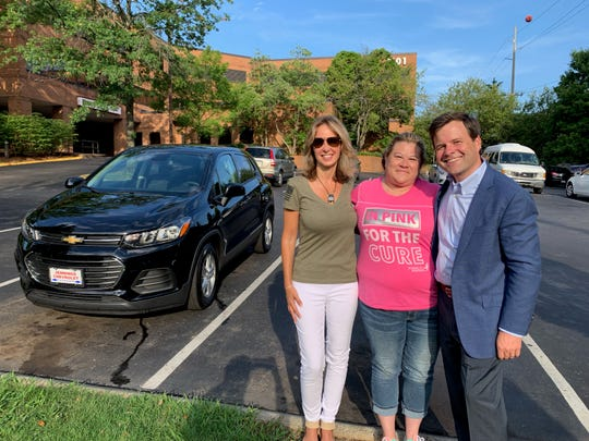 U.S. Air Force veteran and Code of Vets founder Gretchen Smith, left, disabled Veteran Lena Ramon and Twitter philanthropist and businessman Bill Pulte pose in front of Lena's new car July 19 in Nashville, Tennessee.