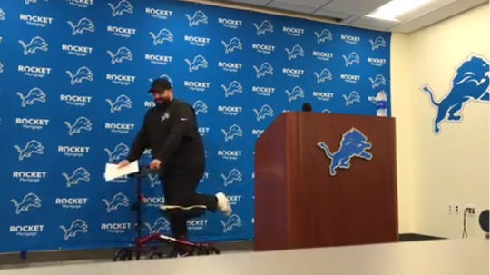 Detroit Lions coach Matt Patricia attends his first news conference of this season's training camp on a knee scooter on Thursday, July 25, 2019 in Allen Park.