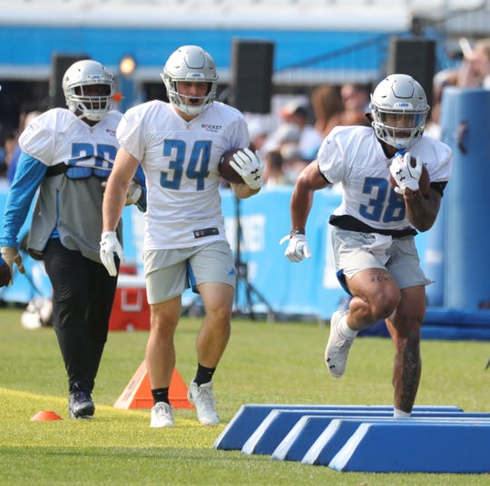 Lions running backs C.,J. Anderson, Zach Zenner and Ty Johnson go through drills during practice during training camp on Thursday, July 25, 2019, in Allen Park.