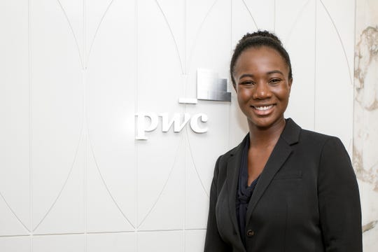 Asabe« Danpollo, an experienced associate for PwC, is photographed at the company office in Detroit in July 2019. Danpollo was happy to take her first job here, in part, because the company has a generous program to help her repay her college loans.