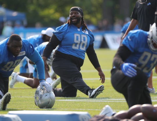 Lions defensive tackle Damon Harrison stretches before practice during training camp on Thursday, July 25, 2019, in Allen Park.