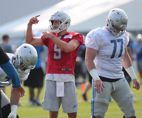 Lions quarterback Matthew Stafford runs the offense during practice during training camp on Thursday, July 25, 2019, in Allen Park.