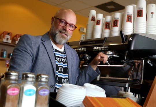 Mike McFall, is a co-CEO of Biggby Coffee standing in one of the companies many stories this one on 9 Mile Road Farmington Hills, Michigan on Friday, July 19, 2019. 