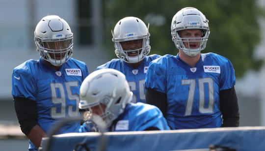 (From left) Lions defensive tackles Romeo Okwara, Jonathan Wynn and Mitchell Loewen go through drills during practice during training camp on Thursday, July 25, 2019, in Allen Park.