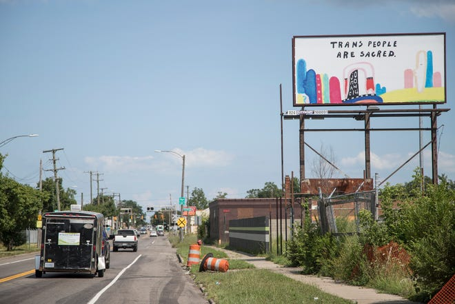 """A sign reads """"Trans People are sacred"""" is seen on Seven Mile Road near Kempa Street in Detroit, Wednesday, July 24, 2019."""