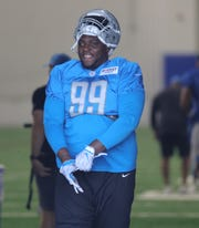 Lions defensive tackle John Atkins walks to the fields before practice during training camp on Thursday, July 25, 2019, in Allen Park.