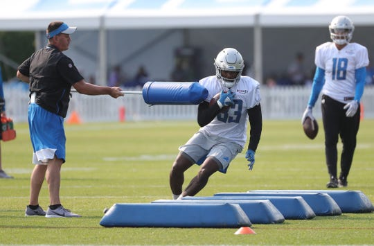 Lions running back Kerryon Johnson goes through drills during training camp Thursday, July 25, 2019 in Allen Park, Mich.