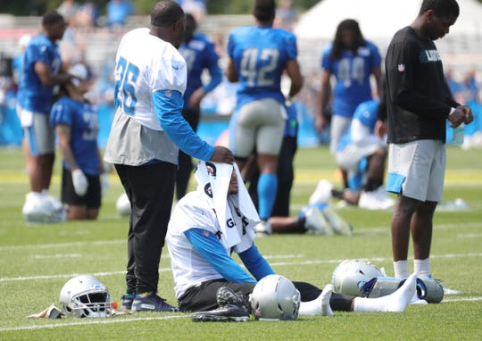 Detroit Lions C.J. Anderson and Jermaine Kearse cool off after training camp on July 25, 2019, in Allen Park.