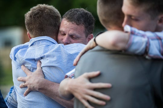 Tyler Wingate's brother Jason Wingate comforts father Jason Wingate as uncle Joe Wingate hugs brother Caleb Wingate after the Wingate family's press conference at Berkley High School in Berkley, Wednesday, July 24, 2019.