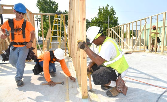 Manic Construction Inc. employees work on the framing for North Pine Street Homes.