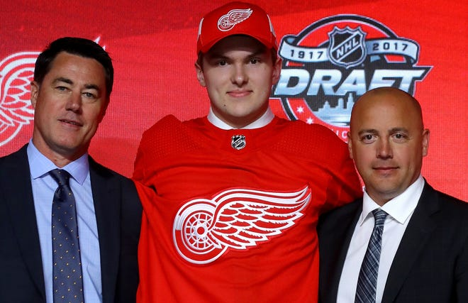 Former Red Wings chief scout Jeff Finley, from left, poses with first-round pick Michael Rasmussen and former head of amateur scouting Tyler Wright at the 2017 NHL Draft in Chicago.