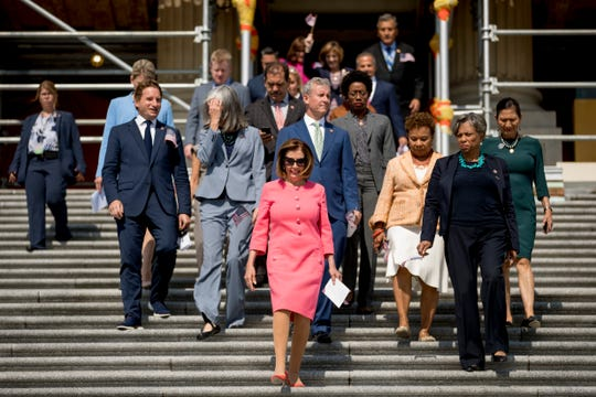 House Speaker Nancy Pelosi of Calif. and House Democrats arrive for a news conference.