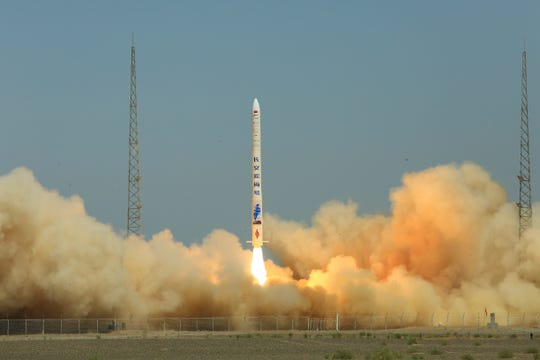 A carrier rocket developed by a Chinese private company successfully launches to send two satellites into orbit from the Jiuquan Satellite Launch Center in northwest China, Thursday, July 25, 2019.