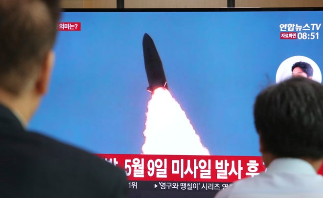 "People watch a TV showing a file image of North Korea's missile launch during a news program at the Seoul Railway Station in Seoul, South Korea, Thursday, July 25, 2019. North Korea fired two unidentified projectiles into the sea on Thursday, South Korea's military said, the first launches in more than two months as North Korean and U.S. officials work to restart nuclear diplomacy. The signs read: ""North Korea fired after May 9."" (AP Photo/Ahn Young-joon)"