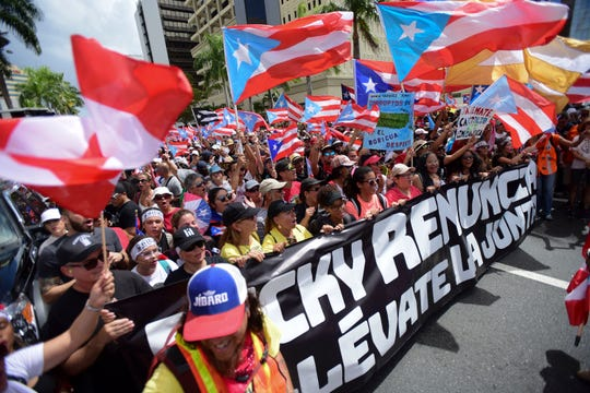 Hundreds of people march to celebrate the resignation of Gov. Ricardo Rossello who announced overnight that he is resigning Aug. 2 after weeks of protests over leaked obscene, misogynistic online chats, in San Juan, Puerto Rico, Thursday, July 25, 2019.