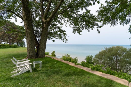 This immaculate lake home was completely remodeled in 2015 and has 170 feet of private frontage on Lake Michigan, including a lush lawn with sweeping water views.
