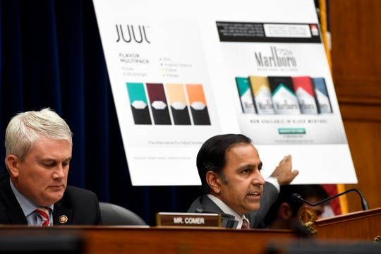 House Oversight and Government Reform subcommittee chair Rep. Raja Krishnamoorthi, D-Ill., right, speaks as he questions JUUL Labs co-founder and Chief Product Officer James Monsees during a subcommittee hearing on Capitol Hill in Washington, Thursday, July 25, 2019, on the youth nicotine epidemic. Subcommittee ranking member Rep. James Comer, R-Ky., is at left.