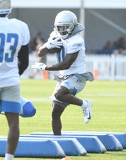 Lions wide receiver Brandon Powell works through obstacles during drills.