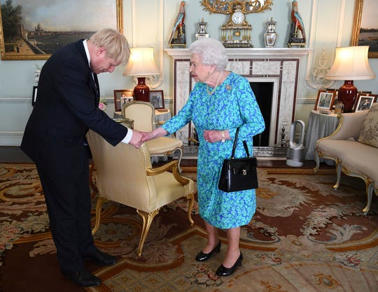 Britain's Queen Elizabeth II welcomes newly elected leader of the Conservative party Boris Johnson during an audience at Buckingham Palace on Wednesday.