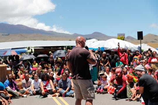 "Actor Dwayne ""The Rock"" Johnson talks to opponents of the TMT telescope on Wednesday."