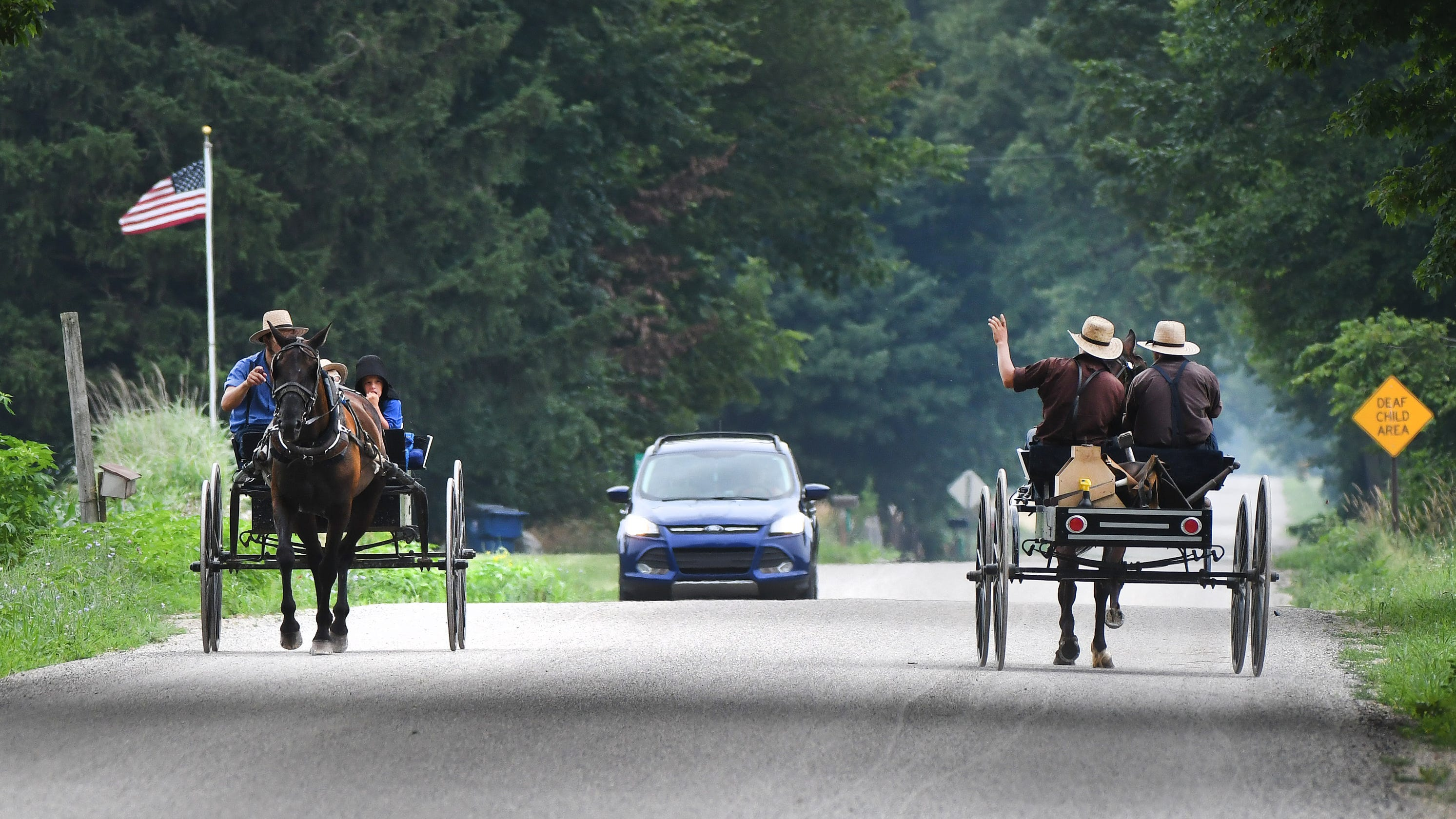 When worlds collide: Amish buggies, heavy vehicles meet with