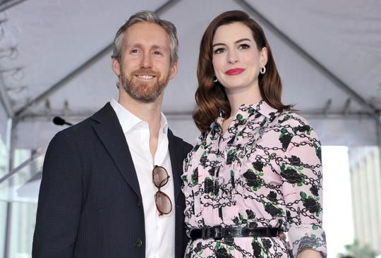 Anne Hathaway, right, and her husband Adam Shulman.