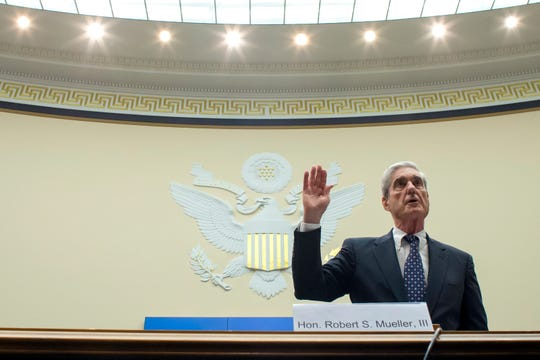 Former special counsel Robert Mueller is sworn in before the House Intelligence Committee to testify on his report on Russian election interference, on Capitol Hill, Wednesday, July 24, 2019, in Washington.