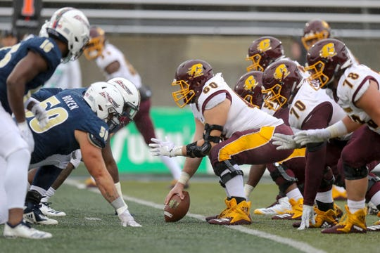 Center Steve Eipper (60) anchors a Central Michigan offensive line that will protect a new quarterback in Quinten Dormady.
