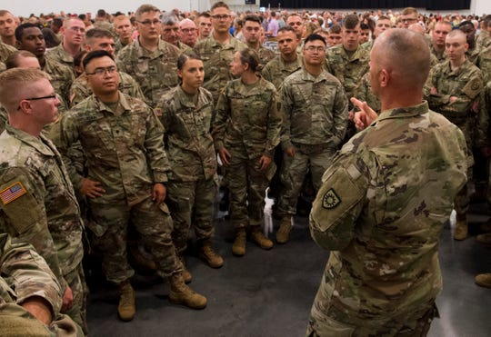 First sergeant Jackie Pogue, right, gives direction to departing soldiers with the 206th Engineer Battalion after their departure ceremony Thursday, July 25, 2019, in Owensboro, Kentucky.
